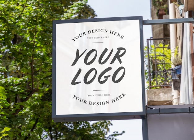 Store brand sign with natural landscape mockup Premium Psd