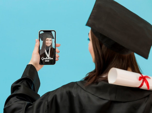 Student celebrating graduation with video call Free Psd