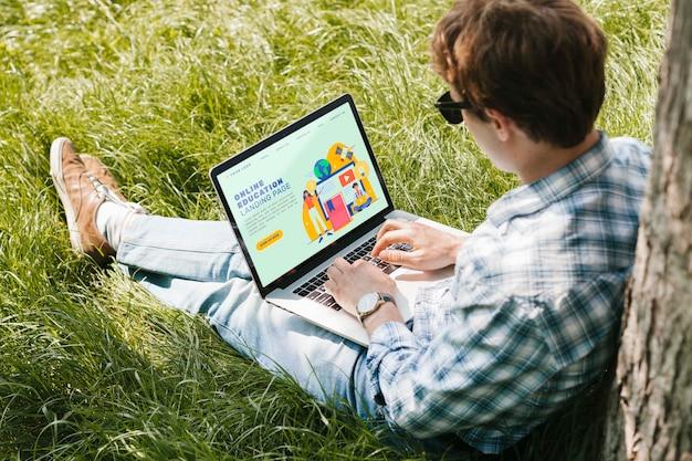Student enjoying study outdoors Free Psd