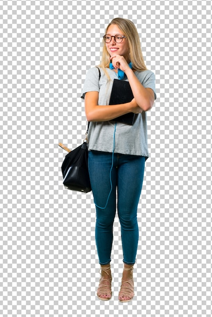 Student girl with glasses standing and looking to the side with the hand on the chin Premium Psd
