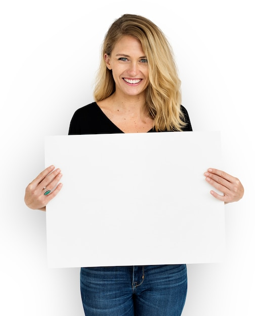 Studio shoot of woman with white paper Free Psd