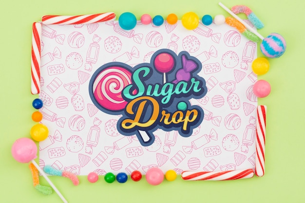 Sugar drop mock-up with delicious candy frame Free Psd
