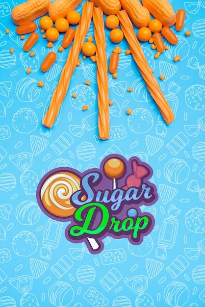 Sugar drop with arrangement of orange candies Free Psd