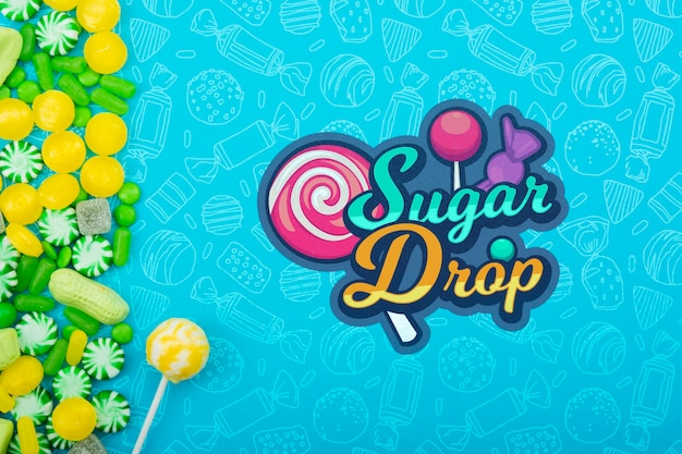 Sugar drop with lollipop stick and green with yellow candy frame Free Psd