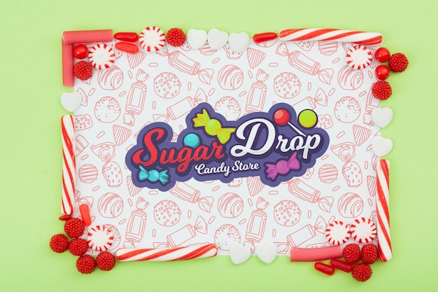 Sugar drop with sugar frame and doodle background Free Psd
