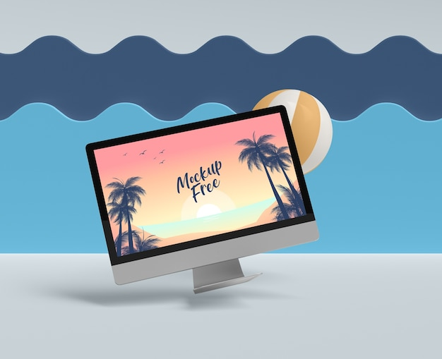 Summer concept with computer and ball Free Psd