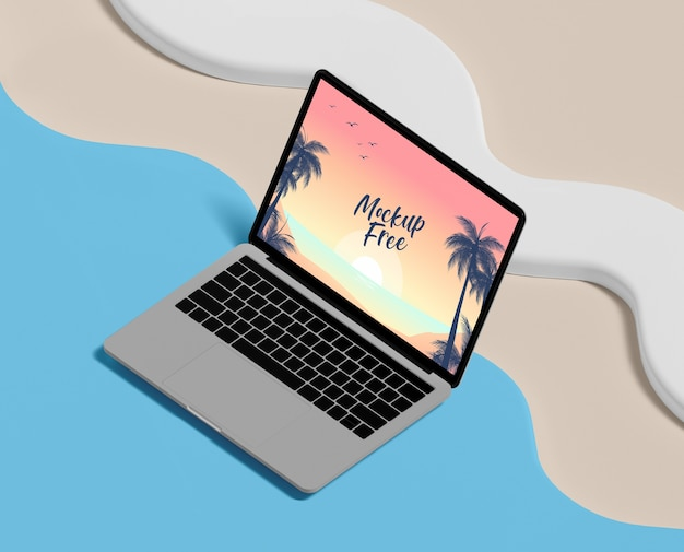 Summer concept with laptop and beach Free Psd