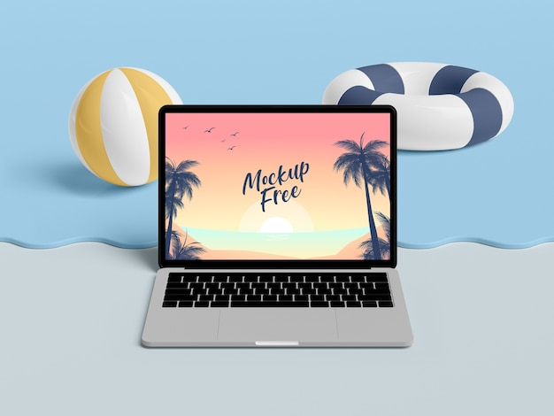 Summer concept with laptop and sea Free Psd