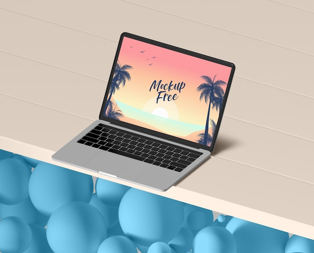 Summer concept with laptop on table Free Psd