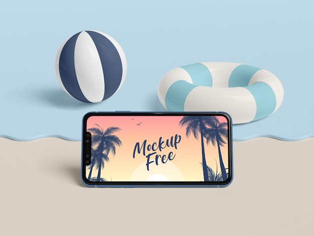 Summer concept with phone and sea Free Psd