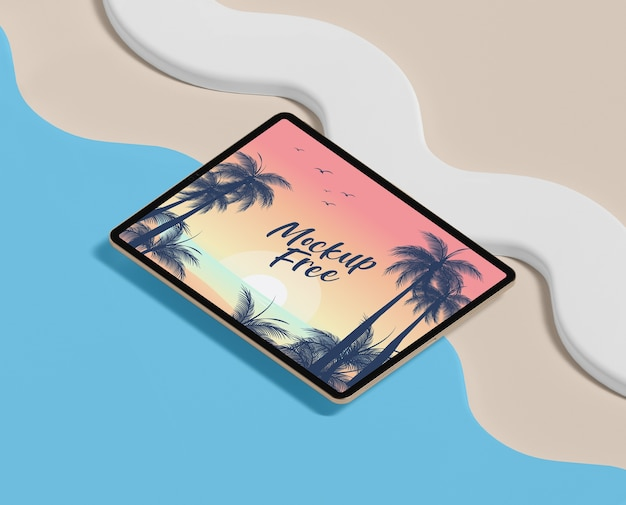 Summer concept with tablet and beach Free Psd