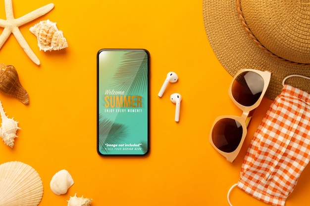 Summer scene with phone mockup and beach accessories, mask Premium Psd