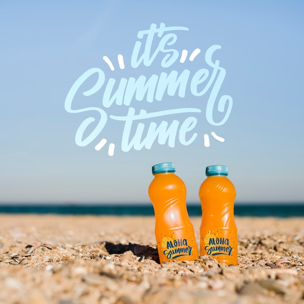 Summer time bottles in the sand mockup Free Psd