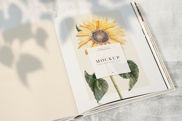Sunflower on a magazine mockup with a blank space Free Psd