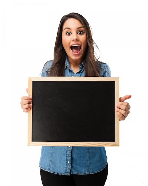 Surprised student with a blackboard Free Psd