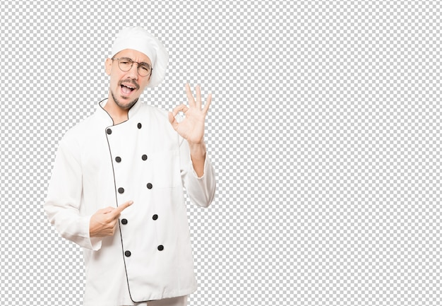 Surprised young chef with a gesture of approval Premium Psd