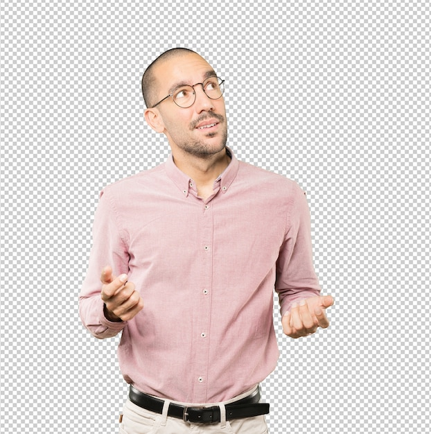 Surprised young man making a gesture of doubt Premium Psd