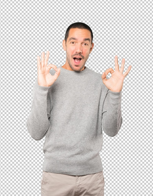 Surprised young man with a gesture of approval Premium Psd