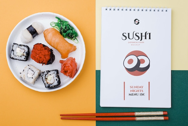 Sushi rolls with notebook Free Psd