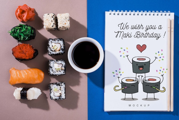 Sushi rolls with soya sauce and notebook Free Psd