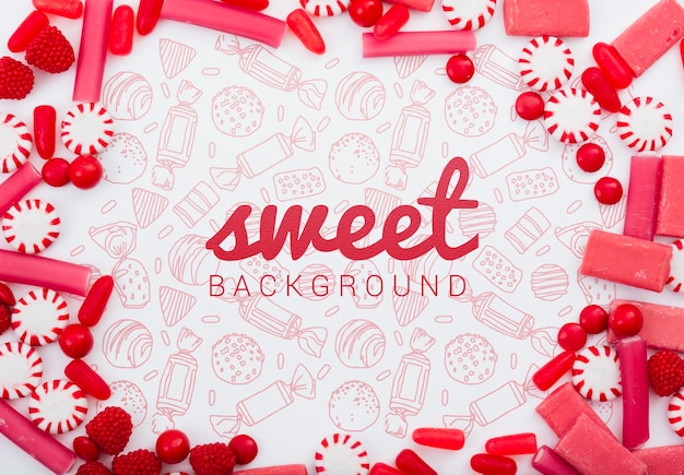 Sweet background surrounded by delicious sugar candies Free Psd