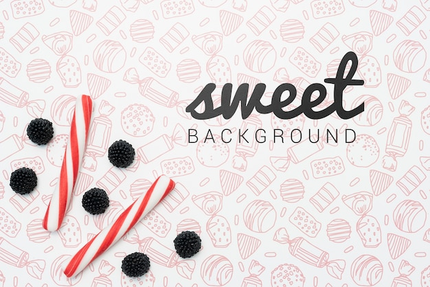 Sweet background with candies and berries Free Psd