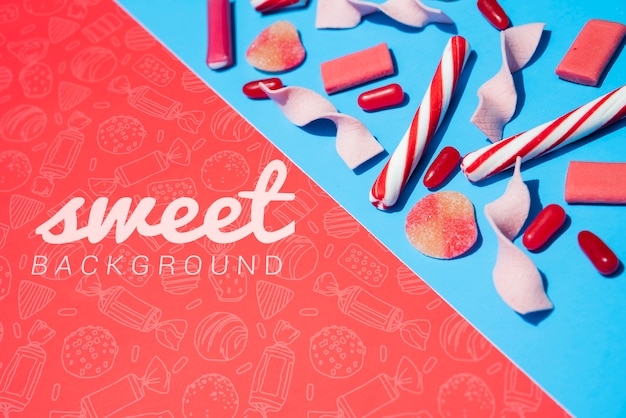 Sweet background with candy sticks Free Psd
