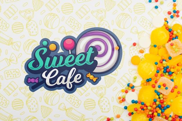 黄色のキャンディーと甘いカフェのロゴ 無料 Psd