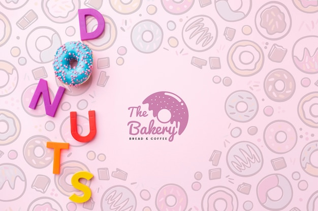 Sweet donut and letters arrangement with mock-up Free Psd