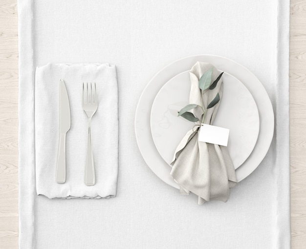 Table setting on white mat Free Psd