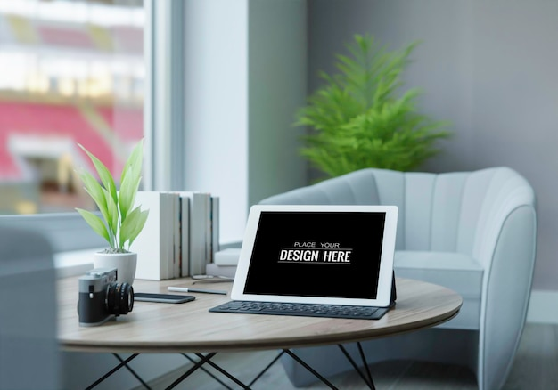 Tablet computer on table mockup Free Psd