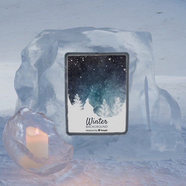 Tablet on ice block light by candle Free Psd