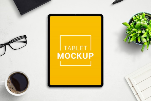 Tablet mockup on office desk. isolated screen for app or web site design promotion. scene creator with separated layers Premium Psd