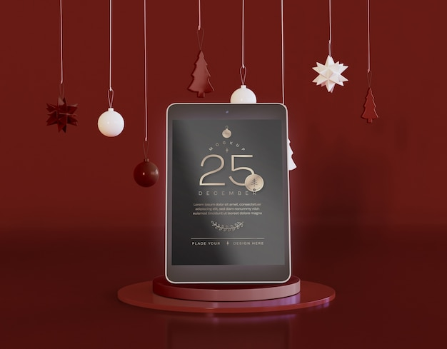 Tablet mockup with christmas decoration Free Psd