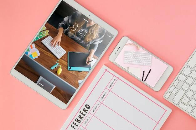 Tablet and smartphone mockup on desk Free Psd