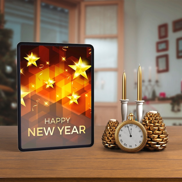 Tablet on table beside decorations Free Psd