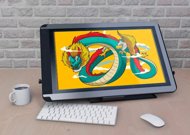 Tablet with artistic drawing on table Free Psd