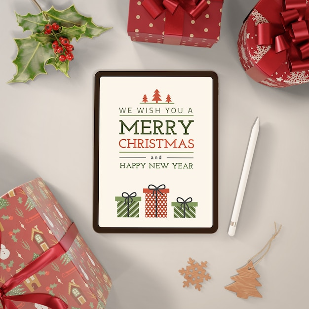 Tablet with merry christmas message Free Psd