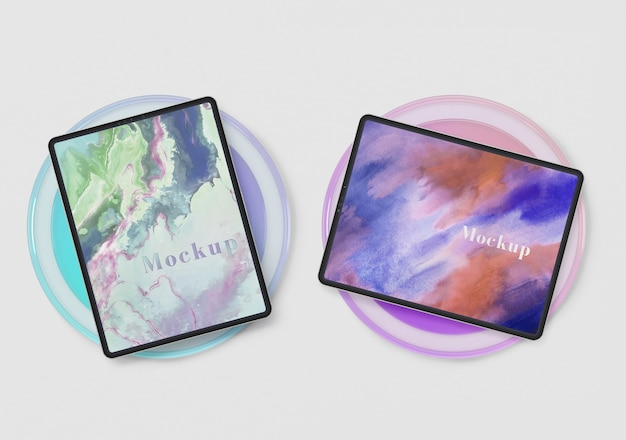 Tablets devices on glass circle support Free Psd