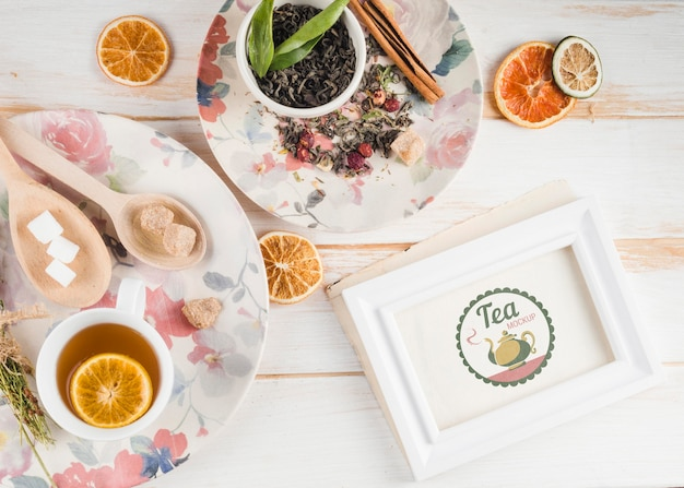 Tea mock-up with citrus and herbs Free Psd
