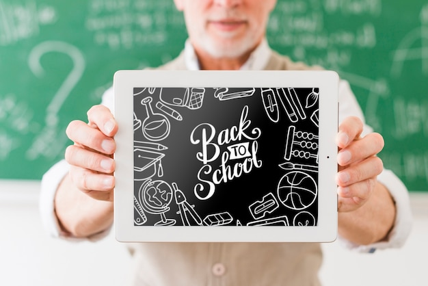 Teacher holding frame with mock-up Free Psd