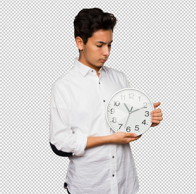 Teenager holding a big clock Premium Psd