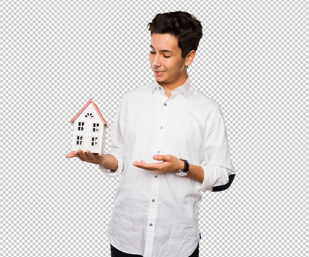 Teenager holding a house Premium Psd