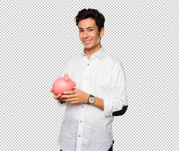 Teenager holding a piggy bank Premium Psd