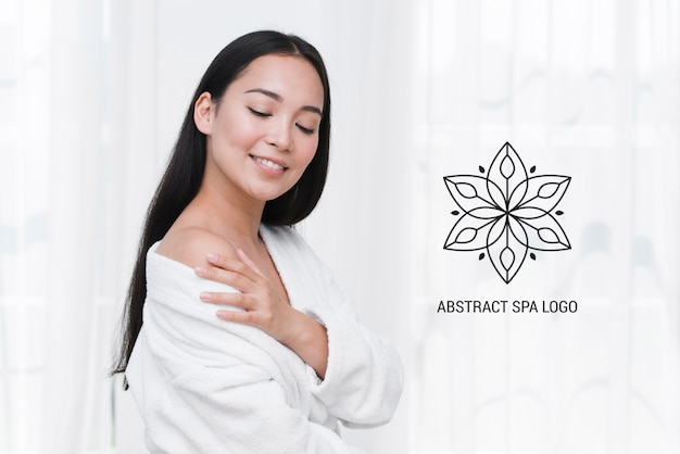 Template smiling woman at spa after massage Free Psd