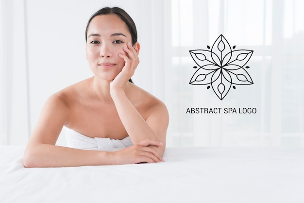 Template with woman posing at spa Free Psd