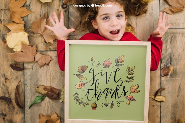Thanksgiving mockup with girl and frame Free Psd