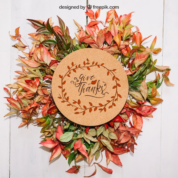 Thanksgiving mockup with leaves and cardboard Free Psd