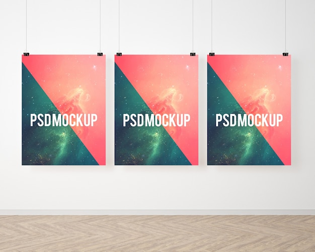 Three posters on white wall mock up Free Psd