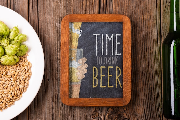 Time for beer sign with seeds on plate Free Psd